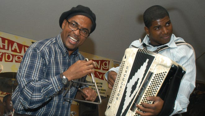 Dennis Paul Williams, left and Nathan Williams Jr. jam at the 2005 Thanksgiving Zydeco Food Drive.