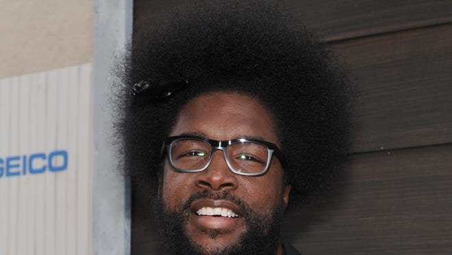 """FILE - In this June 8, 2013 file photo, Questlove arrives at Spike TV's Guys Choice Awards at Sony Pictures Studios in Culver City, Calif. The Roots leader is executive producing a music series for VH1 that will feature three artists performing simultaneously on one stage. """"SoundClash"""" debuts July 23, 2014, with Lil Wayne, Fall Out Boy and buzzed British group London Grammar. (Photo by Frank Micelotta/Invision/AP, File)"""