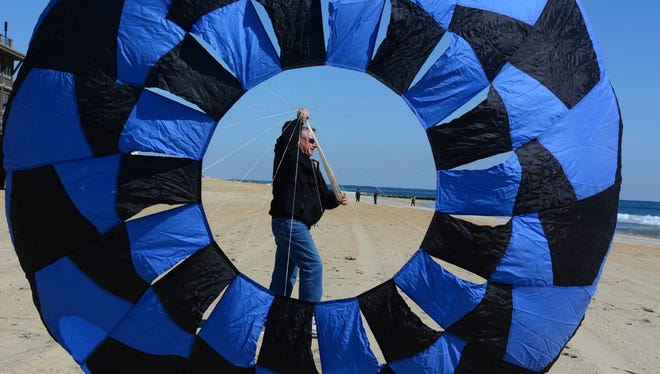 Robert Bender of Rockway launches his kite on the beach between Melrose Terrace and Morris Avenue in Long Branch.