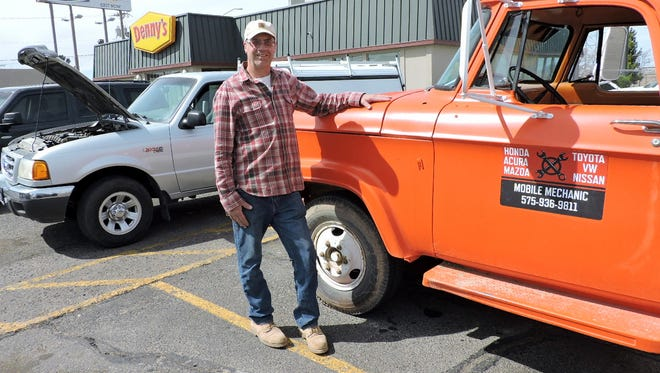 The Mobile Mechanic, Ken Reddinger, with his 1965 Dodge D-300 truck ready to make a house call.