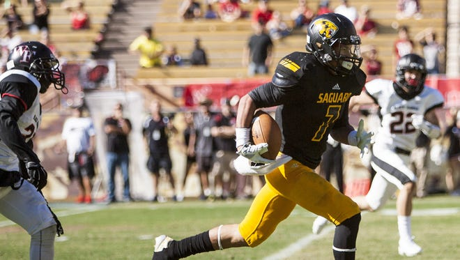 Saguaro Sabercat Byron Murphy (7) runs the ball into the end zone in the first quarter of the division three state championship game against the Williams Field Black Hawks Nov. 29, 2014 in Tempe, Ariz. at the Sun Devil Stadium.