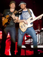 Jerrod Niemann (L) performs on the Main Stage on day three of the Country Thunder Music Festival in Florence, Ariz., April 11, 2015.