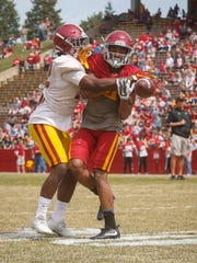 Iowa State freshman defensive back Arnold Azunna, left, breaks up a pass on Saturday, April 8, 2017, during the Iowa State Cyclone football spring game at Jack Trice Stadium in Ames.