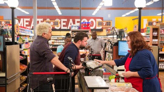 Host Guy Fieri at the check out line with Chefs Robbie