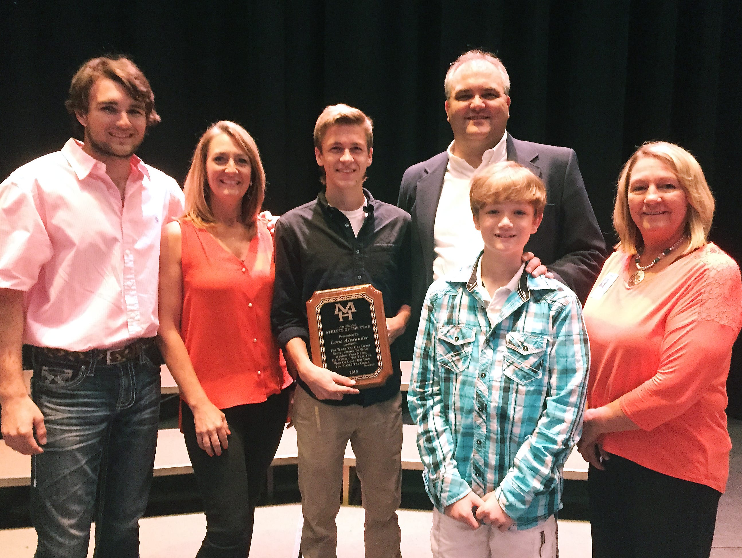 Lane Alexander recently was named the Jim Holsted Athlete of the Year for Mountain Home High School. Shown with Alexander are members of Holsted's family: from left, Dalton Rebsamen, Susan Stockton, Alexander, Mike Stockton, Lawson Stockton and MHHS athletics director Janet Wood.