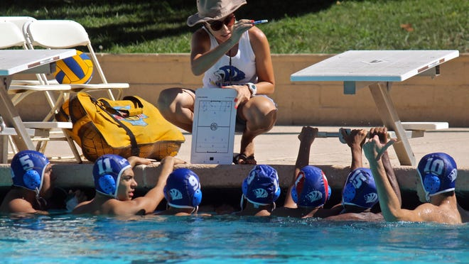Cathedral City Lions coach Stephanie Henderson instructs her players during a boys' water polo match against Rancho Mirage on Aug. 31.