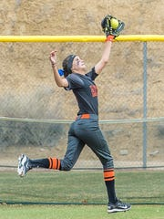 Aztec's Trinity Pollock catches a fly ball in left field during an April 7 game at the Farmington Sports Complex.