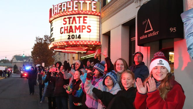 Fans cheer for the Suffern volleyball team during a parade on Lafayette Avenue. The theater marquee was lit in honor of the team.