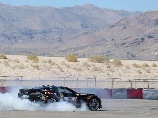 Indy Racing League driver Sam Schmidt roasts the tires in his modified Corvette on Tuesday, Sept. 27, 2016, in Las Vegas. Schmidt, paralyzed from the neck down, is set to receive the first license restricted to an autonomous vehicle in the U.S. The license allows him to drive on Nevada roads in his specially modified Corvette.