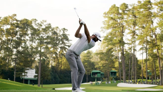 Nov 14, 2020; Augusta, Georgia, USA; Dustin Johnson plays his shot from the 16th tee during the third round of The Masters golf tournament at Augusta National GC. Mandatory Credit: Rob Schumacher-USA TODAY Sports