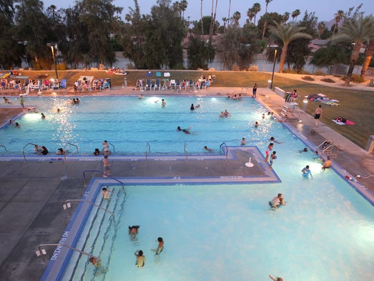 Take a trip to the Aquatic Center in Palm Desert. It features water slides, diving boards and a big pool at an economical price.