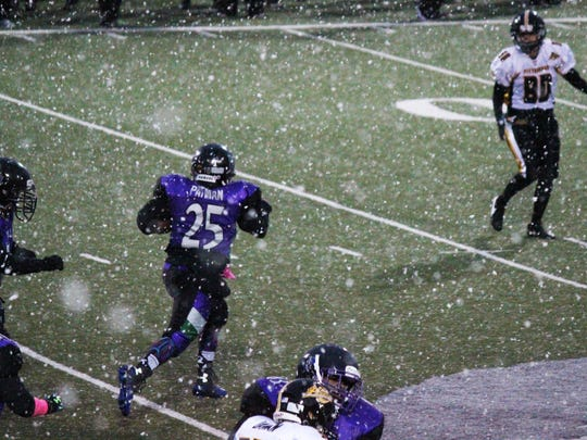 Brianna Patman, running back for Toledo Reign, breaks free for a big gain after snow begins to fall at Don Paul Stadium.