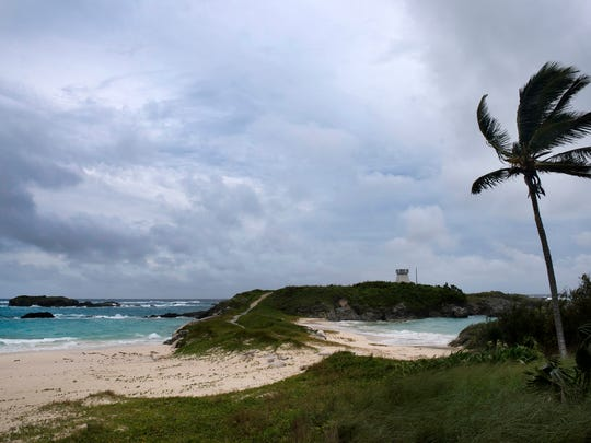 Wind and surf picks up as Hurricane Nicole approaches the Cooper's Island Nature Reserve in St. Georges, Bermuda, Wednesday, Oct. 12, 2016. Wind and rain began battering Bermuda as the British territory braced itself for Hurricane Nicole, which could become a major Category 3 storm before it hits the island on Thursday morning.