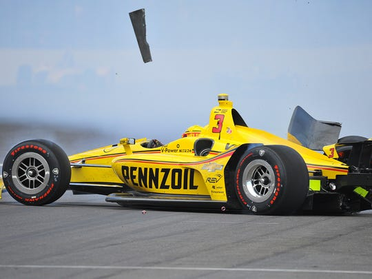 Team Penske IndyCar driver Helio Castroneves (3) crashes