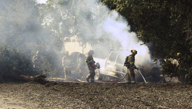 Visalia firefighters extinguish a truck fire Friday afternoon.