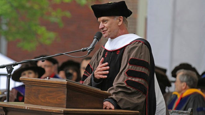 Sting sang for the graduating class during the Brown University commencement after he accepted a Doctor of Humane Letters degree with his wife Trudie Styler on Sunday.