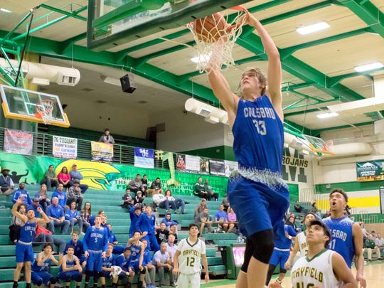 Carlsbad's Brenden Boatwright plows in a dunk in Tuesday's