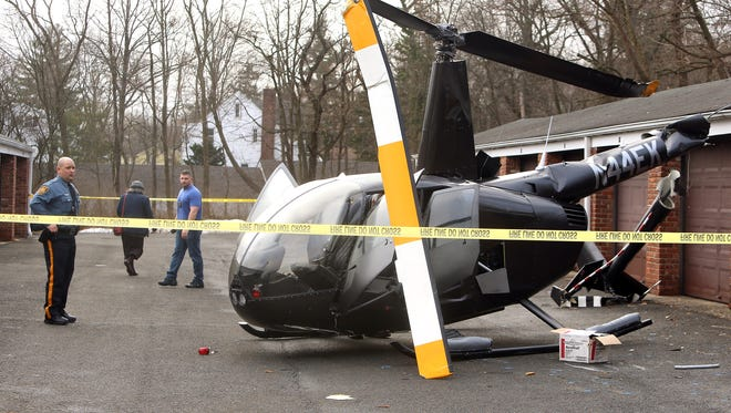 The FAA investigates after a Friday night helicopter hard landing in an apartment complex parking lot off Main Street in Chatham.  February 25, 2017, Chatham, NJ.