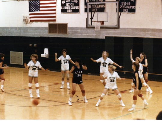 The Liberty Union Lions and Fisher Catholic Irish played at Fisher Catholic in 1985. Included in the photo are cousins playing against each other; Kristin King (34) and Molli McAndrews (25) played for Fisher Catholic against Angela Packard (30) for Liberty Union.