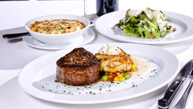 Filet mignon featured with a jumbo lump crab cake on succotash and topped with sweet corn cream at Ocean Prime, opening Dec. 19 in downtown Naples.