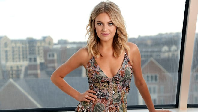In this Jan. 26, 2017, photo, Kelsea Ballerini poses in Nashville, Tenn. Ballerini is nominated for a Grammy Award for best new artist.  The 59th annual Grammy Awards will air live on CBS, Sunday, Feb. 12, from the Staples Center in Los Angeles. (AP Photo/Mark Humphrey)