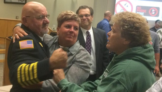 Bellevue Fire Chief Brad Muller celebrates after a Fire Commission hearing on Tuesday in which he was cleared of charges made against him by the International Association of Firefighters Local 141.
