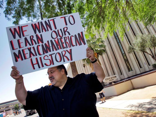 In May 2011, Carlos Galindo protested outside the Arizona