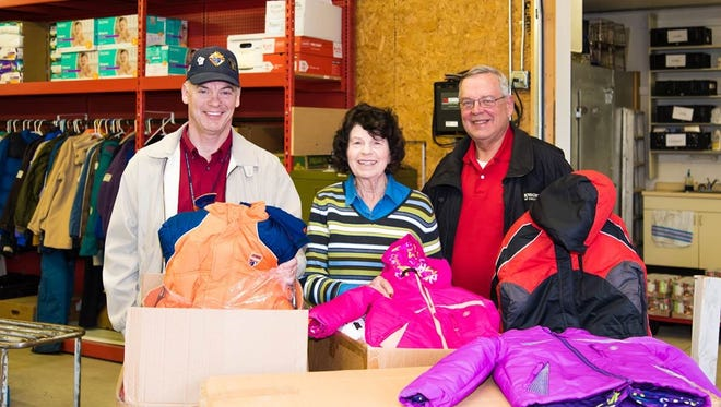 """Operation Bootstrap Director Roseann DeBot (middle) accepts a donation of 71 new children's coats from Knights of Columbus Council 1170 charity committee members Perry Pazdernik (let) and Bob Ostrowski (right).  """"These coats are much needed and welcomed,"""" DeBot said. Nationwide the Knights of Columbus has given away more than 167,000 coats to children in need since the program's inception seven years ago. During this period the KC Council 1170 gave 441 coats to Operation Bootstrap, a community based organization in Stevens Point that helps families in need. We thank all in our community who support our charity projects and Operation Bootstrap."""