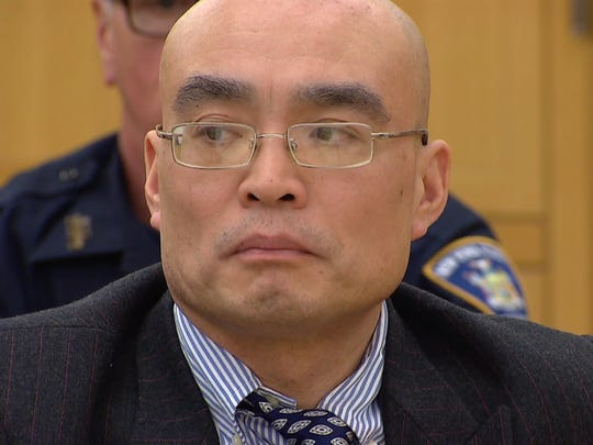 Hengjun Chao listens as his defense attorney attempts