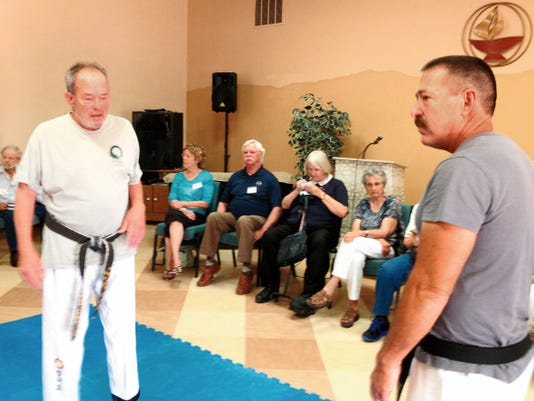 Hiram Lewis, left, and James Fitzgerald, both hapkido black belts, discuss falling safety on Sunday at the Unitarian Universalist Fellowship of Silver City. They discussed ways to prevent falling and demonstrated proper ways to fall. Lewis will offer a free falling safety class at 4 p.m. on Wednesdays at the Recreation Center, located at 1016 N. Silver in the old armory building. Randal Seyler - Sun-News