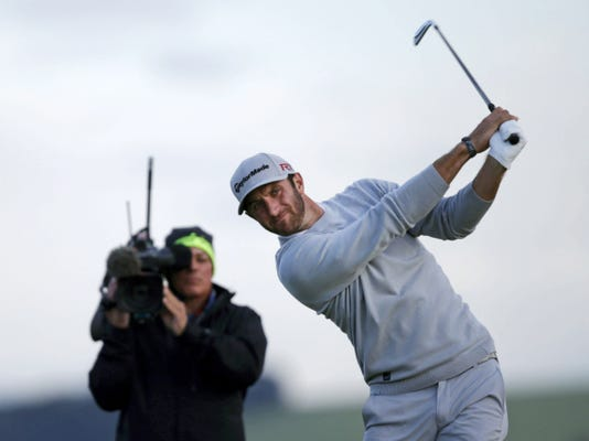 United States' Dustin Johnson tees off from the 7th hole during the second round of the British Open at the Old Course, St. Andrews, Scotland, on Friday.