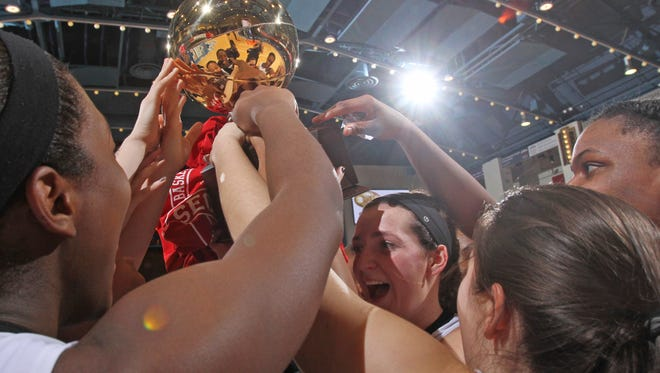 Ossining celebrates their 78-61victory over Lourdes after the Class AA girls basketball final at the Westchester County Center in White Plains March 2, 2015.