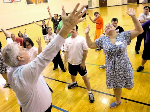 Pierre Dulaine has his students pose in outlandish ways to loosen them up and allow them to enjoy the dance. Dulaine, a world champion dancer, was in Nashville to teach confidence and self-esteem through the steps of the foxtrot, tango and other dances to those with Down syndrome.  The Dance Like No One is Watching camp taught participants of all ages ballroom dancing Tuesday July 8, 2014, in Nashville.