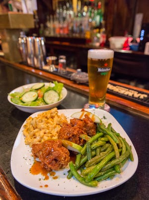 Twisted Soul's caramel wings with macaroni and cheese and green beans.