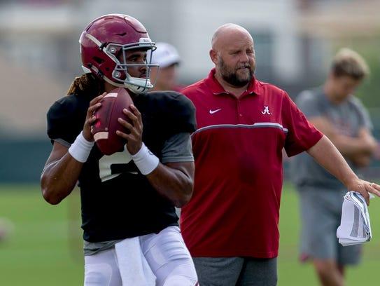 Alabama quarterback Jalen Hurts (2) works through drills