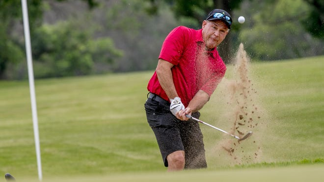 Team TazWood's Tim Sheppard fires out of a bunker Sunday at Pekin Country Club during River Cup competition against Team Peoria.