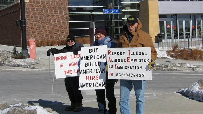 From left, Robert Ussery of Des Moines, Russ Dorsey of Altoona and Ron Duncan of Missouri Valley picket against illegal immigration Saturday outside the Home & Garden Show in downtown Des Moines in 2007. The men represented the Iowa Minutemen, which favors tightened security on the U.S.-Mexican border.