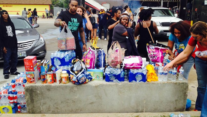 Ten Hoosiers traveled to Ferguson, Mo., to deliver supplies to demonstrators.