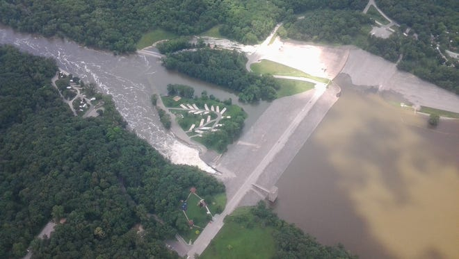 Water is seen creeping up to the spillway at Coralville Lake on Thursday afternoon. The latest projections from the U.S. Army Corps of Engineers for Coralville Lake have the water cresting at 710 feet above sea level Thursday, where it will remain until July 13 and begin to slowly decline.