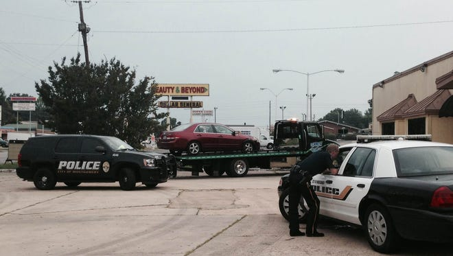 A 2003 Honda Accord is towed off after a female driver struck a man on a bicycle Friday morning.