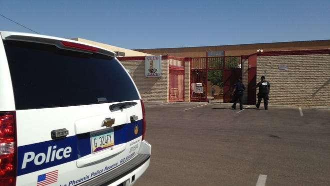 Phoenix police served a search warrant at a strip club near 27th Avenue and Indian School Road on May 14, 2014, as part of an investigation into a house of prostitution.