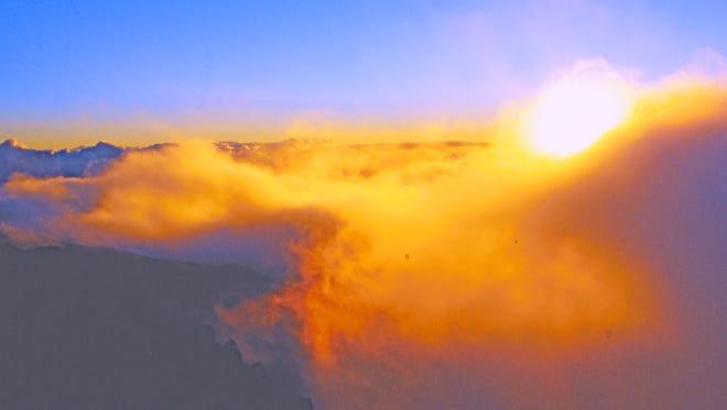 The sun rises at Haleakala in Hawaii.