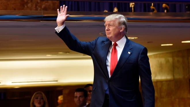 Donald Trump waves before announcing that he is running for president on June 16, 2015, in New York.