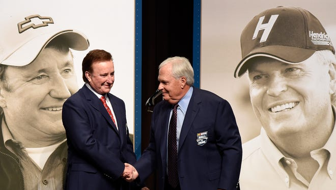 NASCAR team owners Richard Childress, left, and Rick Hendrick shake hands after receiving their Hall of Fame jackets prior to the Class of 2017 induction ceremony Friday night.