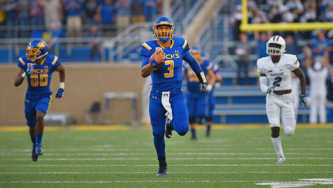 South Dakota State University, Taryn Christion, runs 90 yards in the first quarter during the game against Duquesne University Thursday, Aug. 31, in Brookings.