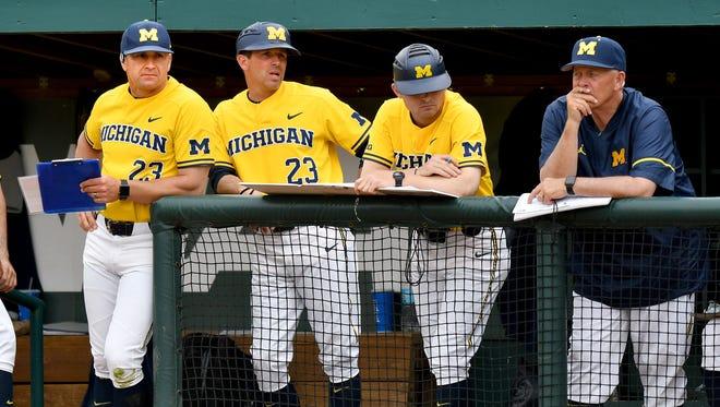 Michigan coach Erik Bakich, left
