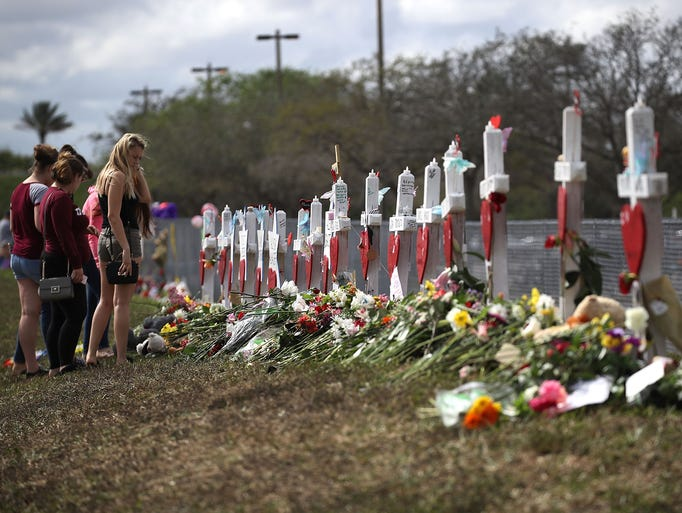 People visit a makeshift memorial setup in front of