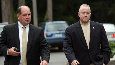 Andrew DeStefano, right, a former New York City police captain who had been running for Putnam County sheriff but dropped out of the race abruptly just before the primary, arrives at Southeast Town Court Sept. 27, 2009 in this file photo.