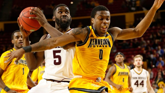 Arizona State forward Obinna Oleka looks to shoot against Kennesaw State guard Kendrick Ray during the first half at Wells Fargo Arena in Tempe on November 18, 2015.
