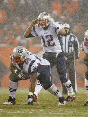 New England Patriots quarterback Tom Brady (12) calls a play against the Denver Broncos last Sunday. Brady has thrown 28 touchdown passes this season, with just four interceptions.